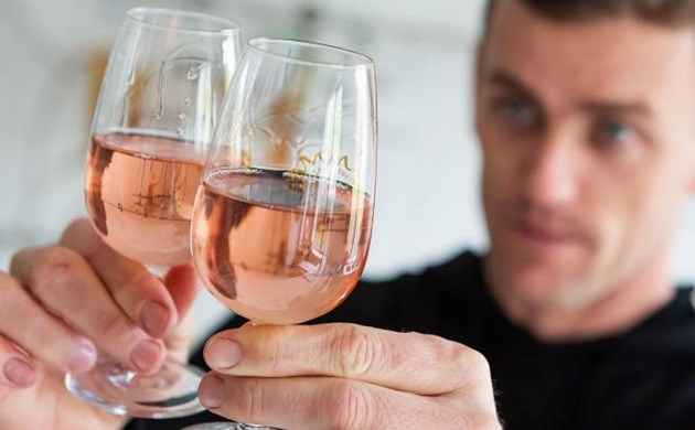 A man holding two glasses of a pink wine from Untitled Wines