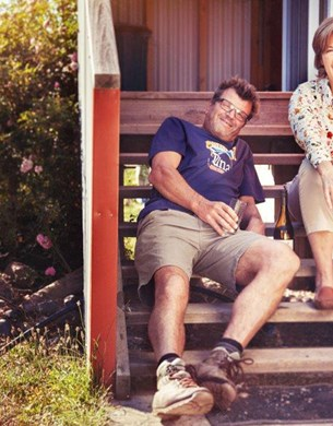 Kim and Eric Crawford from Loveblock wines sitting on some steps