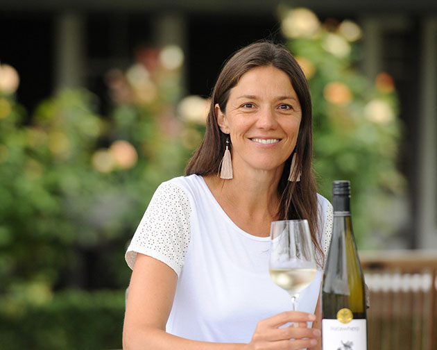Kirsten Searle holding a glass of white wine