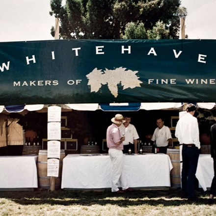 Whitehaven banner on a stall with people