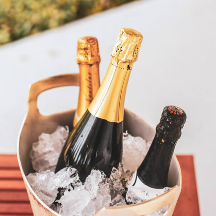 Sparkling wines in an ice bucket.