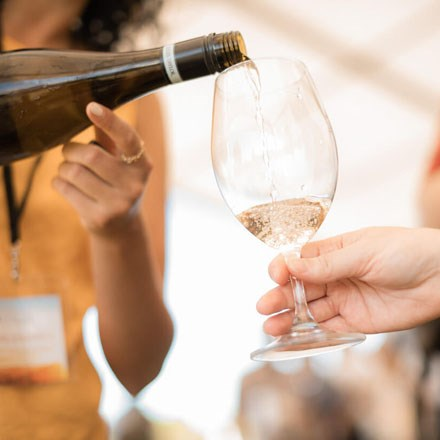 Chardonnay being poured into a glass.