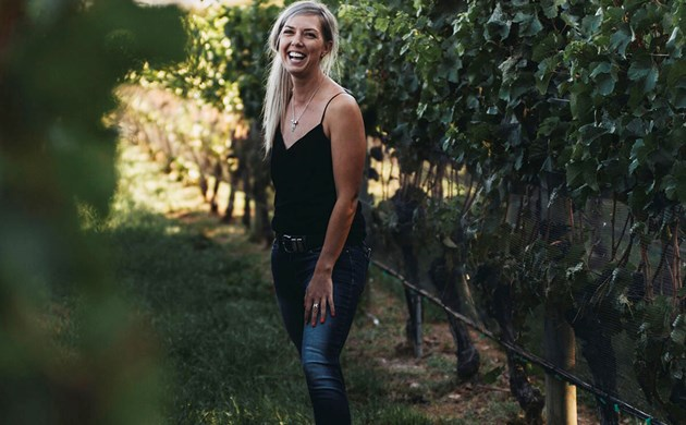 Alice Rule standing in vine rows