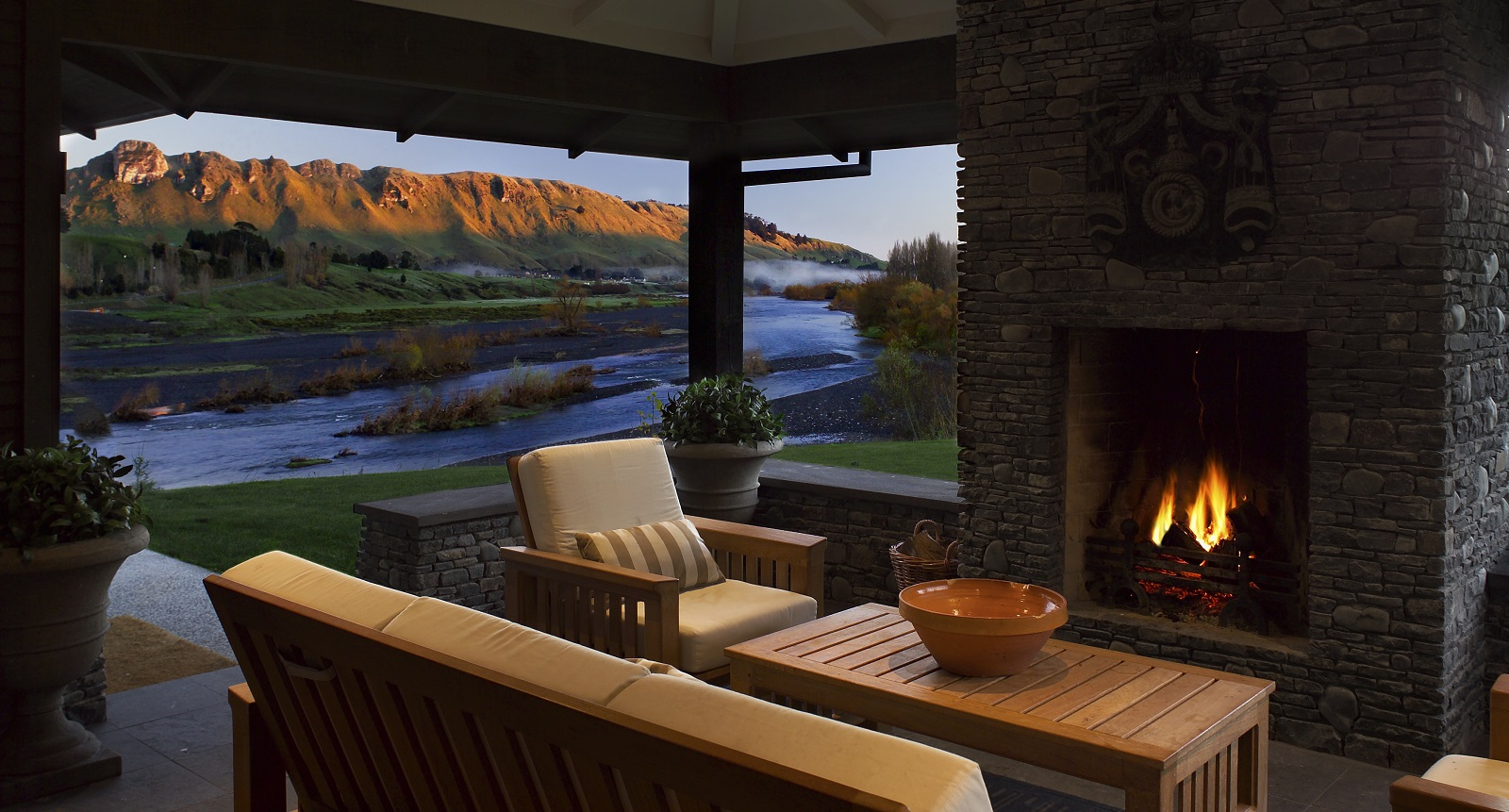 The fire place and interior of accommodation at Black Barn, Hawke's Bay.